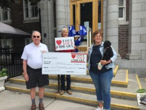 Pictured on the steps of the Picton Branch Library are: Don Wakefield, Chair of the Library Board Devon Jones, and Alexandra Bake, fundraising chair with fundraising mascot Chico.